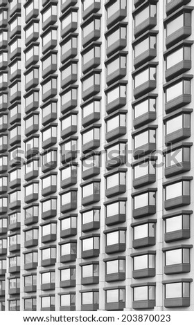 Glass windows of the building, vertical, monochrome style.stock photo.