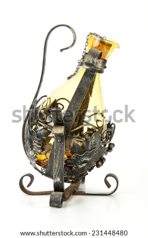 glass wine decanter in ornate metal swivel frame - stock photo