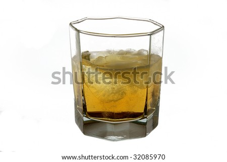 Glass with a drink, it is photographed on a white background.