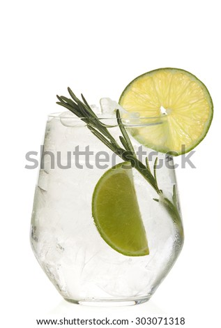 Glass with alcoholic drink with lime and ice isolated on white background. - stock photo