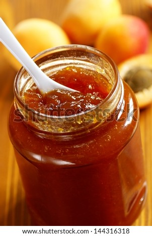 Glass with apricot jam and fresh apricots