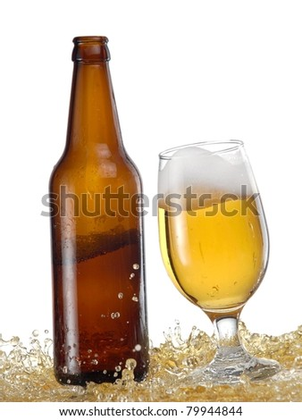 Glass with beer and a bottle splash