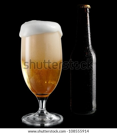 Glass with beer and a bottle with drops