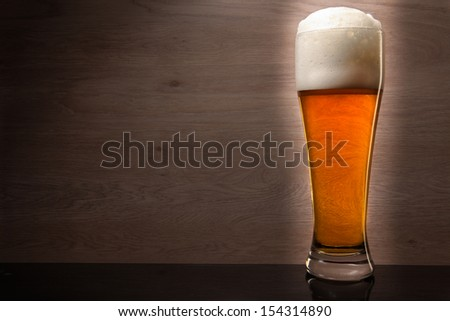 Glass with beer served on the table.