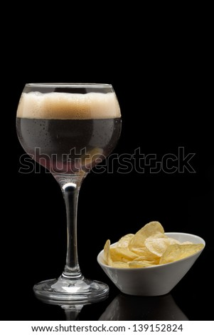 Glass with black beer - stock photo