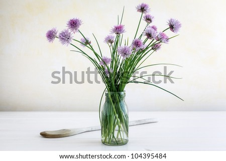 Glass with blooming chive.