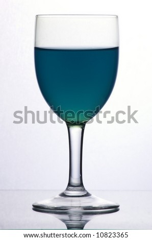 Glass with blue liquid