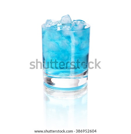 glass with blue water and ice - stock photo