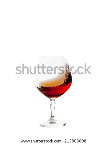 glass with brandy and splashes isolated on white background - stock photo