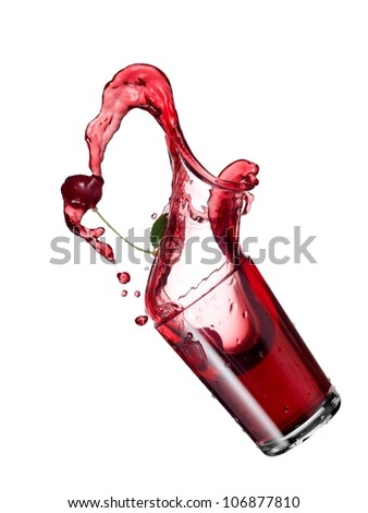 Glass with cherry juice up - stock photo