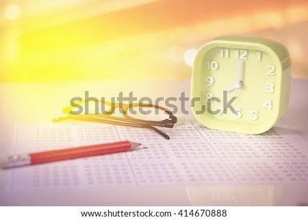 Glass with clock in exam concept