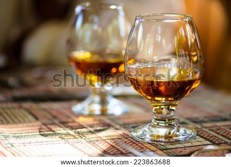 glass with cognac - stock photo