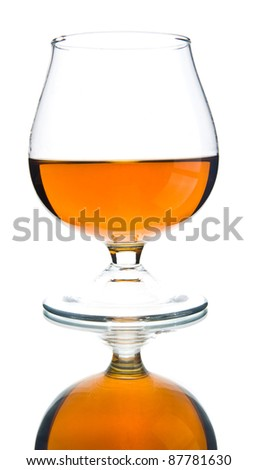 glass with cognac on a white background - stock photo