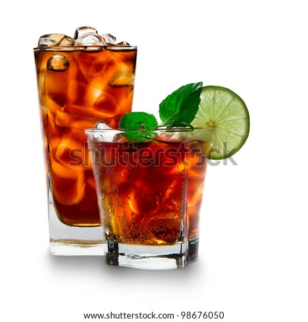 Glass with cola and ice cubes over white - stock photo