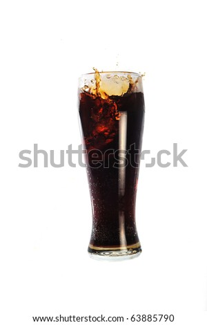 glass with cold drink costs on table - stock photo