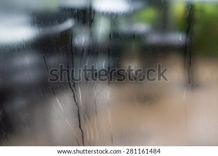 Glass with condensation in vivid colors - stock photo