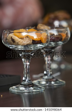 glass with different dried fruits