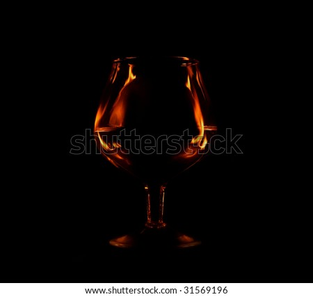 glass with fire flames and copyspace inside the glass - stock photo