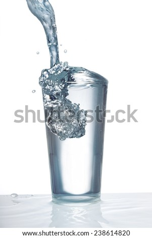 Glass with fresh drinking water - stock photo