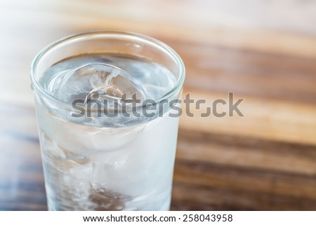Glass with Ice Cold Water. - stock photo
