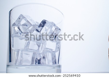 glass with ice cubes - stock photo