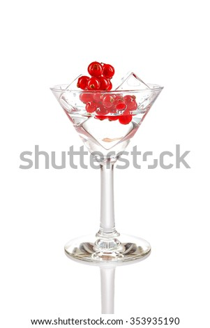 Glass with ice cubes and cranberry. Isolated on white - stock photo