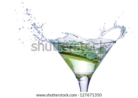 Glass with juice and lemon on the white background - stock photo