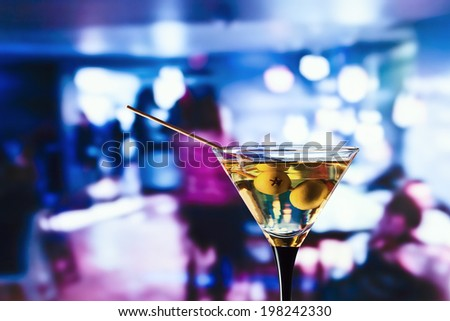 glass with martini , focus on a olives - stock photo