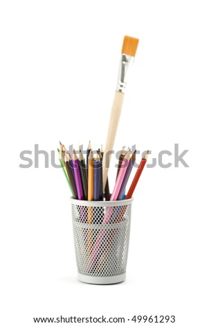 glass with pencils and brush
