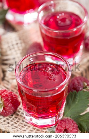 Glass with Raspberry Liqueur and some fresh fruits