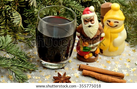 Glass with red wine and branch tree on table - stock photo