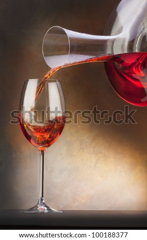 glass with red wine and decanter