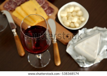 Glass with red wine on served table