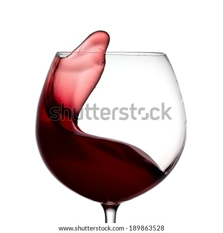 Glass with red wine plash - stock photo