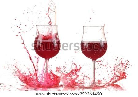 Glass with red wine splash - stock photo