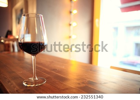 glass with red wine, tasting, restaurant - stock photo