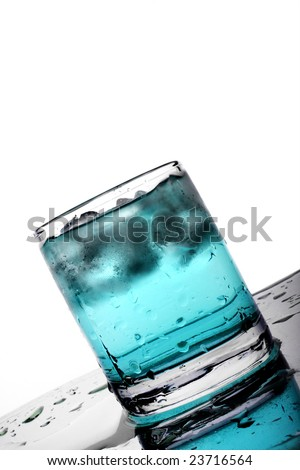 Glass with sapphire blue beverage and ice