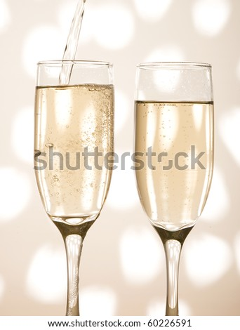 Glass with shampagne on the creative background - stock photo