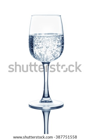Glass with soda water on isolated background - stock photo