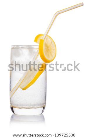 glass with straw, ice cube, crushed ice, lemon slice - stock photo