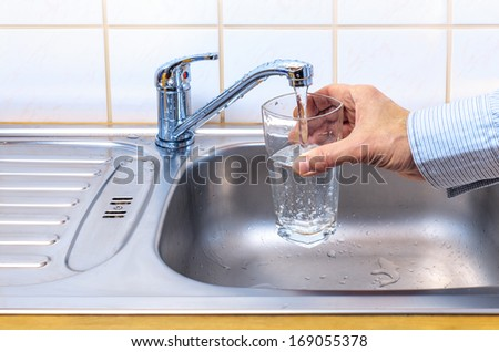 glass with  tap water - stock photo