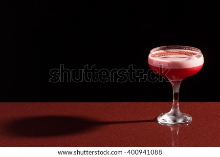 glass with the red cocktail - stock photo