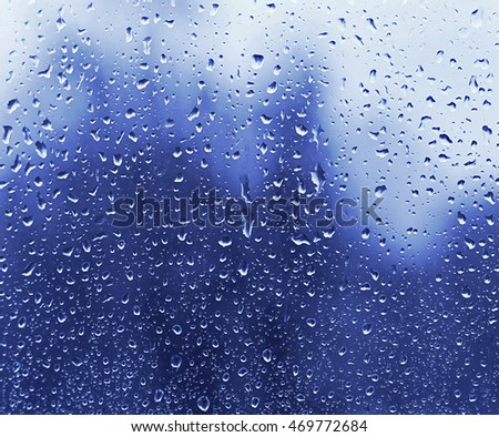 Glass with water drops, blue natural texture