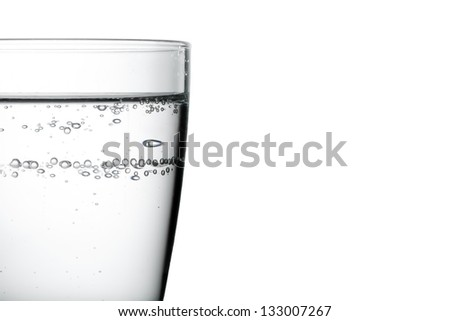 glass with water on white background with space for text
