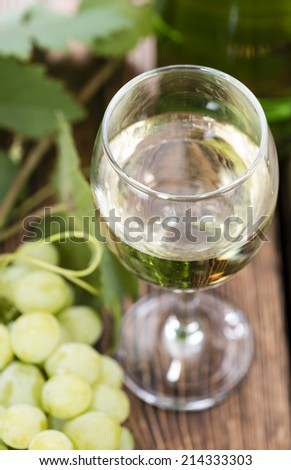 Glass with White Wine and fresh grapes