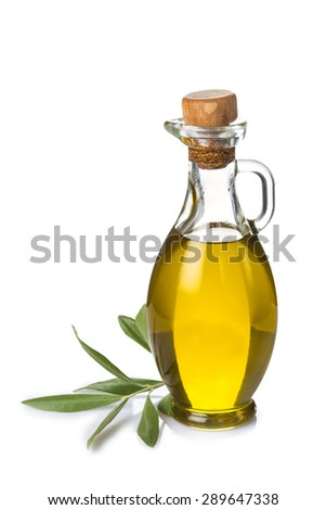 GlassbBottle with extra olive oil and olive branch isolated on a white background - stock photo