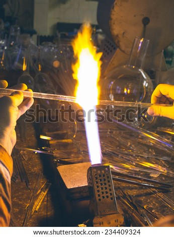Glassblower products laboratory equipment and glass abstract background. Work place chemistry glass