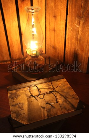 Glasses and antique books - stock photo