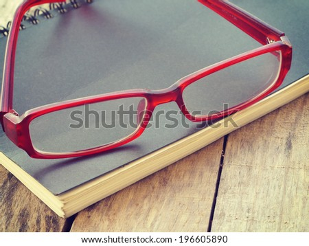 glasses and book retro-vintage style - stock photo