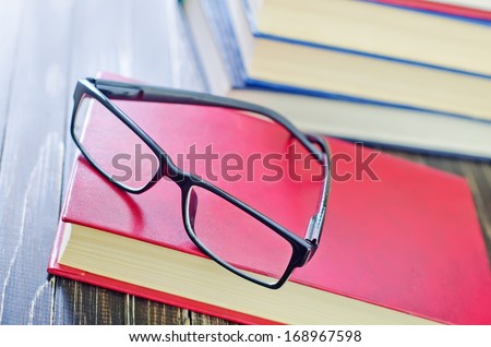 glasses and books - stock photo